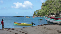 Fisherman at boats Soufriere St Lucia beach HD 1578 Stock Footage