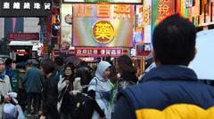 Hong Kong mainland Chinese tourists at Nathan Road shopping China Asia Stock Footage
