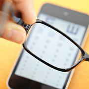 eyechart on mobile with eyewear - stock photo