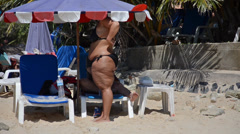 Stock Video Footage of overweight woman at beach