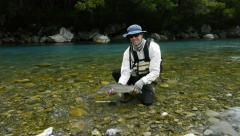 New zealand brown trout and angler Stock Footage