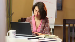 Woman house keeper working over internet at home, freelance job - stock footage