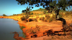 Hot climate nature landscape of mountain lake, tree and blue sky. Myanmar travel Stock Footage