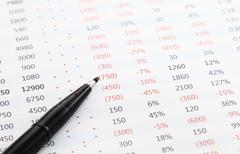 Data spreadsheet and pen Stock Photos