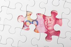 Incomplete puzzle over chinese yuan banknote background Stock Photos