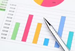 graphical chart and pen - stock photo