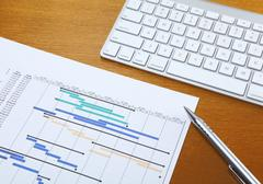 gantt chart and keyboard - stock photo