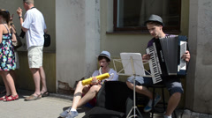 street musicians play music accordion wind-instrument in street - stock footage