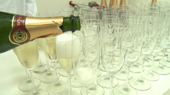 A close-up of pouring champagne or sparkling wine into tall glasses Stock Footage