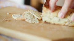 Bread cutting with sharp knife - closeup Stock Footage
