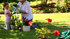 Grandmother gardening with her granddaughter Stock Footage