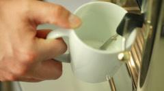Man making milk foam using cappuccino machine Stock Footage
