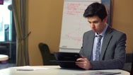 Stock Video Footage of Business man reading news on tablet PC, financial updates index