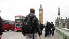 Students acrossing westminster bridge london red bus Stock Footage