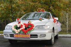 White wedding car decorated with flowers Stock Photos