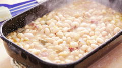 Fresh cooked white beans steaming in casserole- closeup - stock footage
