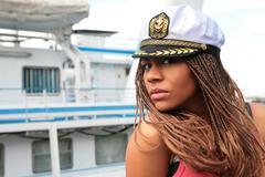 black girl in the white captain cap - stock photo