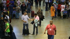 Passengers walk through Guarulhos Airport on in Sao Paulo, Brazil Stock Footage