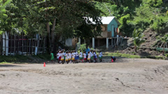 Soufriere St Lucia school children exercise on beach HD 1576 Stock Footage