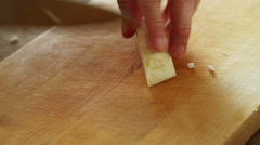 Stock Video Footage of Celery root - slicing with sharp kitchen knife