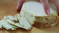 Celery root - peeling with kitchen knife - closeup Stock Footage