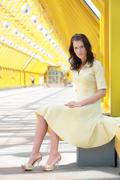 Young woman in yellow dress Stock Photos