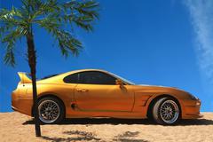 Sport Car on Gold Sand - stock photo