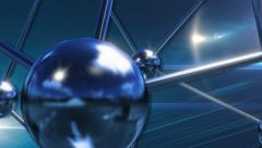 Abstract rotating chrome atomic particles turquoise blue background Stock Footage