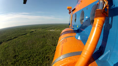 A helicopter flies over the taiga. Stock Footage