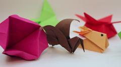 Pan across origami items, traditional Japanese art of paper folding Stock Footage
