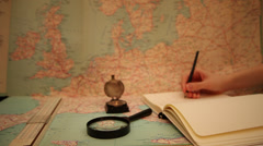 Writing in a notebook, ship's register, measurements,geography, map, instruments Stock Footage