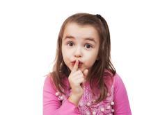 Stock Photo of girl shows hush sign