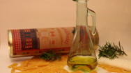 Stock Video Footage of Pouring olive oil in a glass bottle, Italian pasta, Mediterranean cuisine
