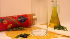 Penette falling into a glass cylinder, dried Italian pasta, cuisine Stock Footage
