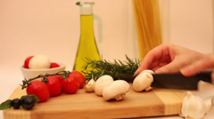 Chopping mushrooms, healthy lifestyle, cooking, Italian cuisine,fresh vegetables Stock Footage