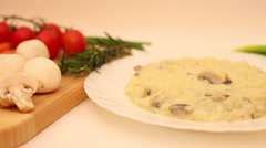 Risotto with mushrooms hot plate,steam, rice and vegetable dish, Italian cuisine Stock Footage