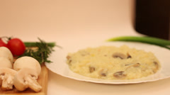 Risotto with mushrooms hot plate, steam, rice, vegetable dish, Italian cuisine Stock Footage
