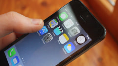 Searching for apps on the iPhone - stock footage