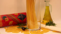 Woman hand removing dried spaghetti from a glass cylinder, Italian cuisine,pasta Stock Footage