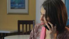 Phone talking woman in pink gown, divorced female seeking dating, click for HD - stock footage