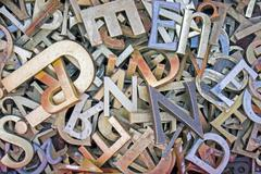 Pile of different iron letters Stock Photos