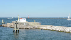 The harbor entrance from Warnemunde in the Baltic Sea. Stock Footage