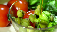 Stock Video Footage of Olive oil flows in salad. Close up