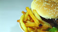 Hamburger with fried potato in rotation on  white background. Macro Footage