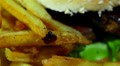 Hamburger with fried potato in rotation. Macro HD Footage