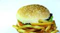 Hamburger with fried potato in rotation. Macro Footage