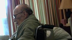 Elderly Man Sits By Window - stock footage