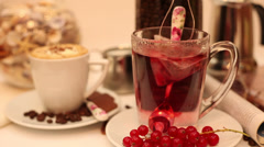 Making red currant tea, fresh berry fruits, coffee, breakfast Stock Footage