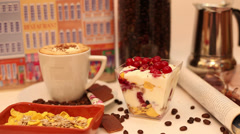 Pouring chocolate flakes over yogurt, fresh fruits and cereals, breakfast Stock Footage