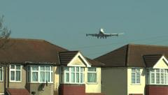 British Airways Boeing 747 viewed over houses close to London Heathrow. Stock Footage